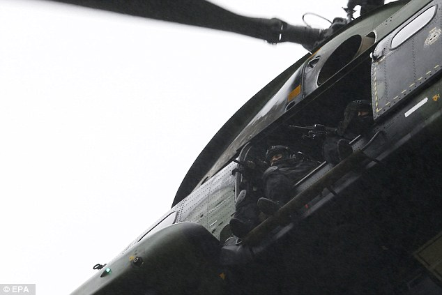 Surveillance: A French army helicopter flies over the industrial area where Charlie Hebdo massacre suspects were hiding