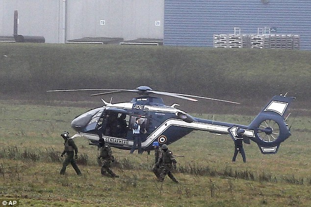 Hostile force: Police take their positions around the Kouachi brothers' location in Dammartin-en-Goele