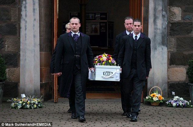 Locals wept as the small, white coffin was brought from the church after the service