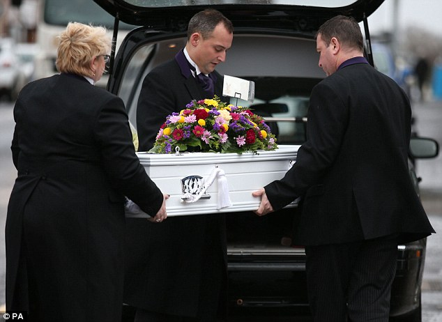 The five-year-old's coffin is brought into the Alva Parish Church in the town near Stirling today