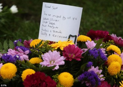 Flowers from the family were accompanied by the message: 'Beloved Scott. You are missed by all of us'