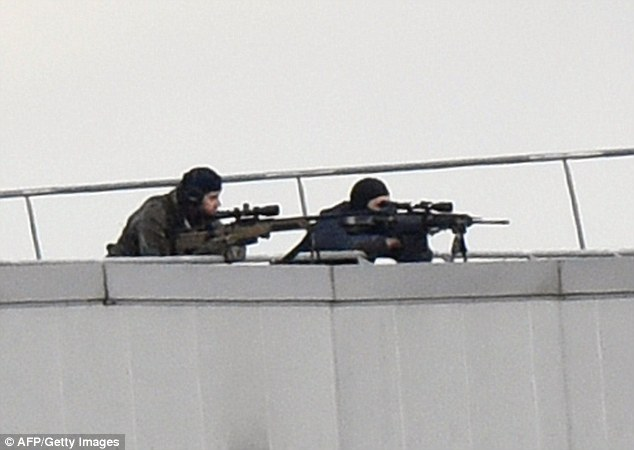 Taking position: Special forces snipers fix their gaze on the position of the Kouachi brothers