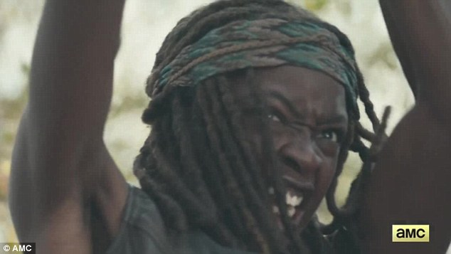 Samurai of the apocalypse: Michonne (Danai Gurira) grimaced as she raised her trusty katana at more unseen enemies - dead or otherwise