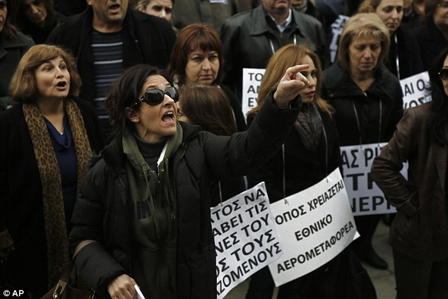 Workers demonstrated against the ruling outside the Finance Ministry in Cyprus after the airline suspended its operations