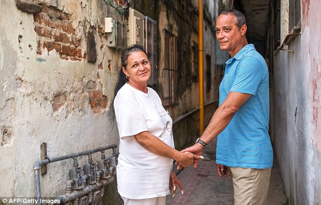 Cuban dissident Angel Figueredo, right, and his wife, Haydee Guallardo, left,  are pictured here on Monday in Havana, Cuba. Figueredo and Gallardo were released from prison as part of an agreement aimed at ending decades of hostility between Cuba and the United States