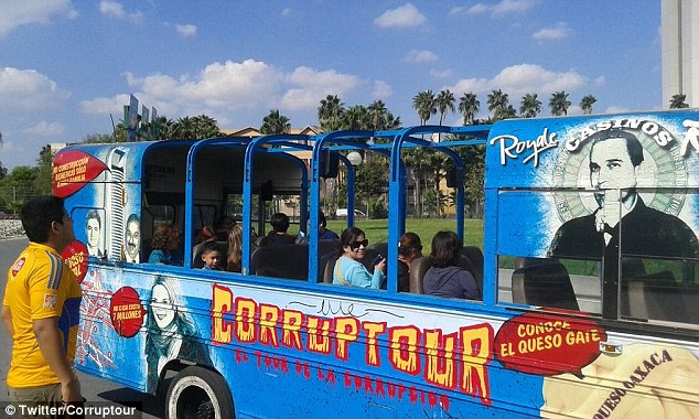 The blue bus is painted with the faces of local politicians alongside pigs and rats clutching bags of money