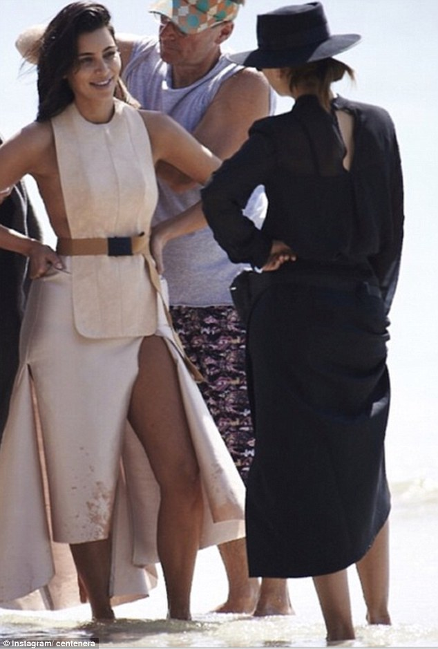 Candid and stunning: Afresh-faced Kim Kardashian is just as glowing in a new-behind-the-scenes photo from her recent shoot with Vogue Australia as she chats to fashion director Christine Centenera on set