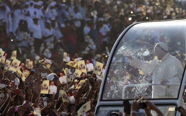 Pope Francis, right, arrives in Colombo's seafront Galle Face Green for the  canonization ceremony of Joseph Vaz, Wednesday, Jan. 14, 2015. Pope Francis pres...