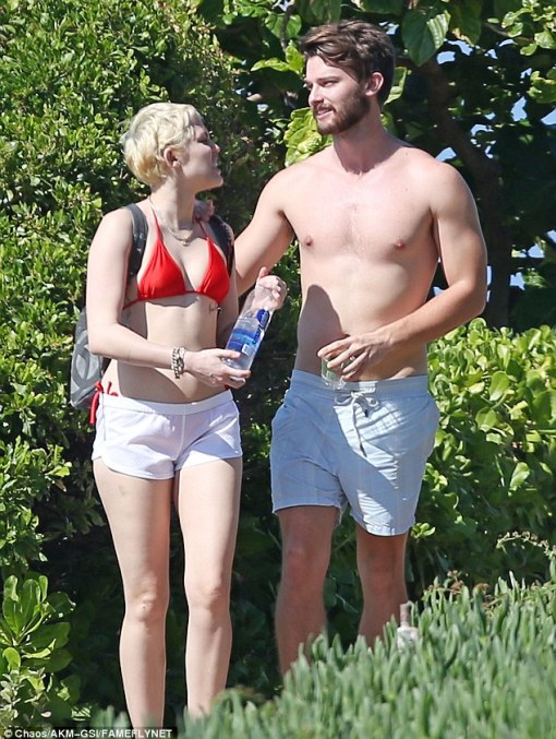 Red hot! The Wrecking Ball hitmaker showed off her willowy figure in a red bikini with tiny white shorts