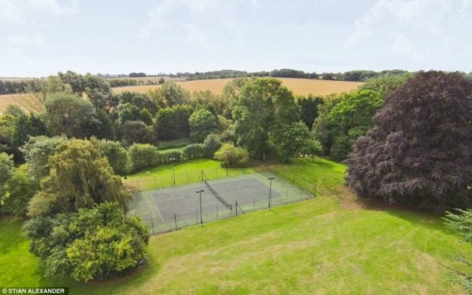 For those who do not fancy the beautiful game, the property also features a flood-lit tennis court in case of a fifth set tie-break