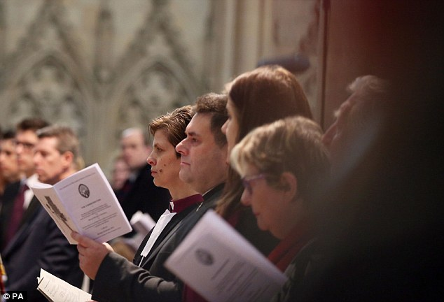 Service: The new bishop looks straight ahead during the service of her consecration