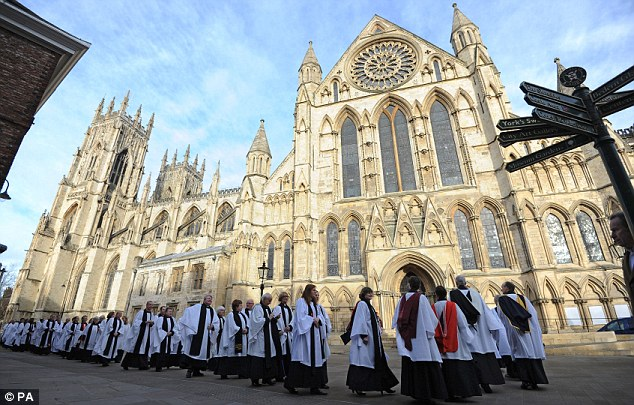 Procession: Dozens of church officials attended the service at York Minster today