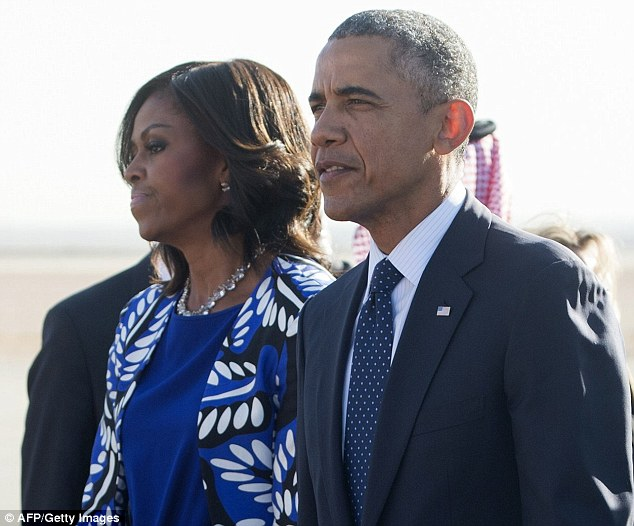 Letting her hair down: Mrs Obama did not wear a headscarf on Tuesday, though Saudi women are required not to let any of their hair show in public. Western women who visit the country do not need to cover their hair, but conservative dress like the outfit sported by the First Lady is necessary