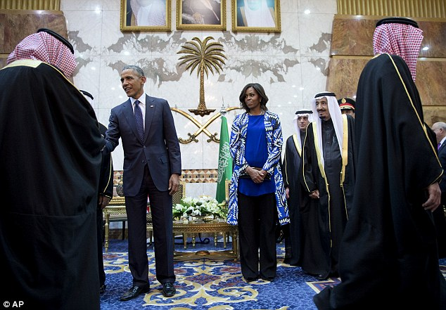Life as a woman in Saudi Arabia: Other restrictions placed on women include not being able to go out in public without a male escort,  open a bank account without their husband's permission or try on clothes while shopping. Mrs Obama stands between her husband and King Salman on Tuesday
