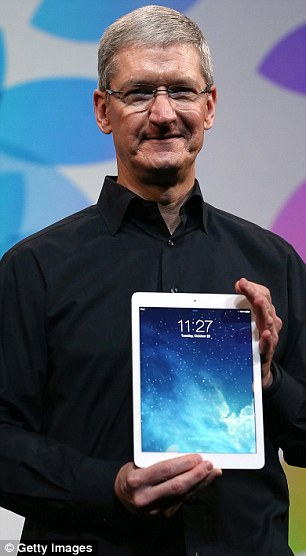 Staggered: Apple's chief executive Tim Cook and his staff can hardly believe their own success