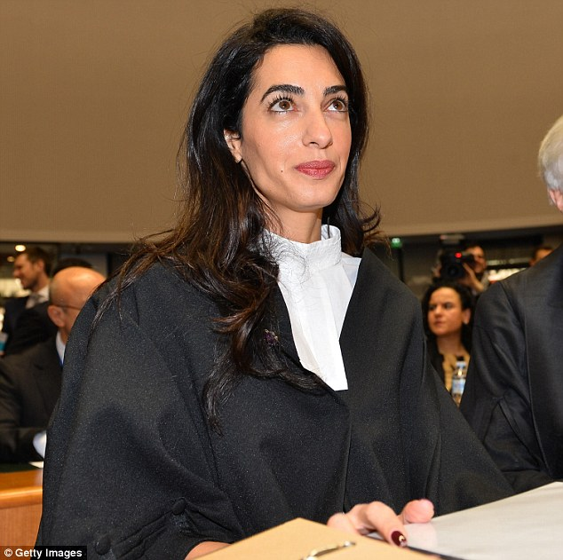 When  asked about fashion, Mrs Clooney joked that she was wearing robe maker Ede & Ravenscroft