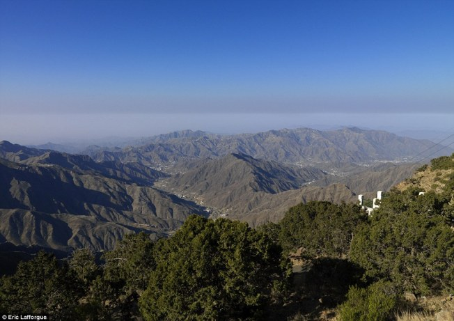 Remote: The stunning view of the Habala Mountains taken from Rijal Alma reveals just how remote the flower men's home is