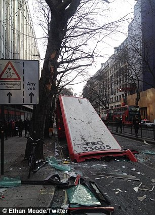 Scotland Yard said three bus passengers and a motorist had been injured in the collision