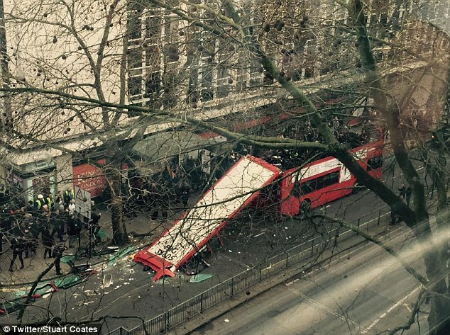 Shards of glass from the windows of the bus also littered the road, with the roof trailing behind the vehicle, as stunned passengers were seen still sitting on the ruined top deck