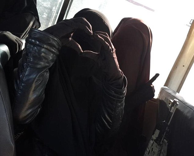 Brain washed: The Halane twins have posted a number of pictures on their accounts where they are dressed completely in black and brandishing deadly weapons - just like their Al-Khansa sisters