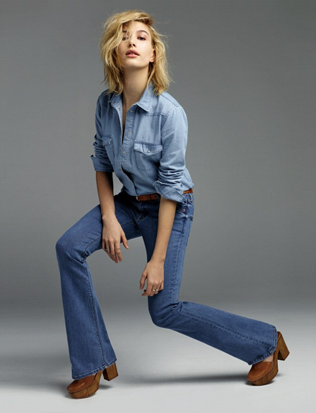 Jeanius: She struck up an intricate pose while wearing double denim