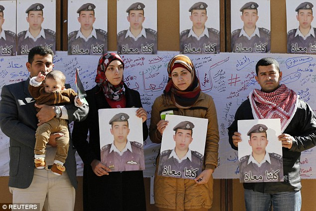 Relatives of Moaz al-Kasasbeh held pictures of him at a rally calling for his release early yesterday