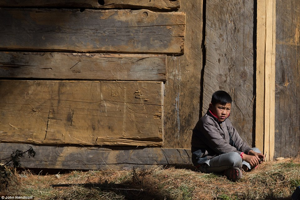 A Bhutanese boy sits alone as the country prepares for its first International festival, a ten-day celebration coinciding to the King's birthday