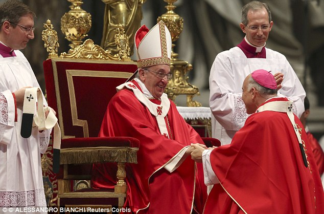 Archbishop  Cordileone (right) is greeted after receiving the sacred pallium from Pope Francis (seated) at St. Peter's Basilica in the Vatican in June