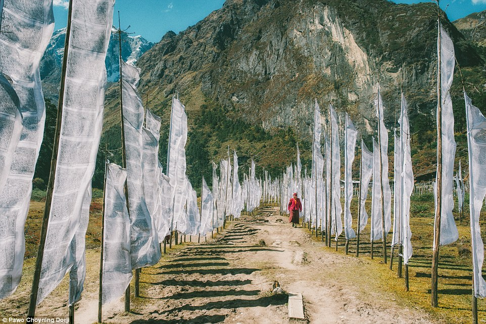 Prayer flags are raised outside homes, hung on bridges, hilltops, and places of spiritual importance