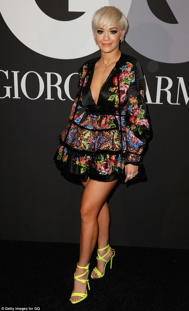 Taking the plunge: Rita Ora stunned in a floral mini dress at theGQ and Giorgio Armani Grammys afterparty