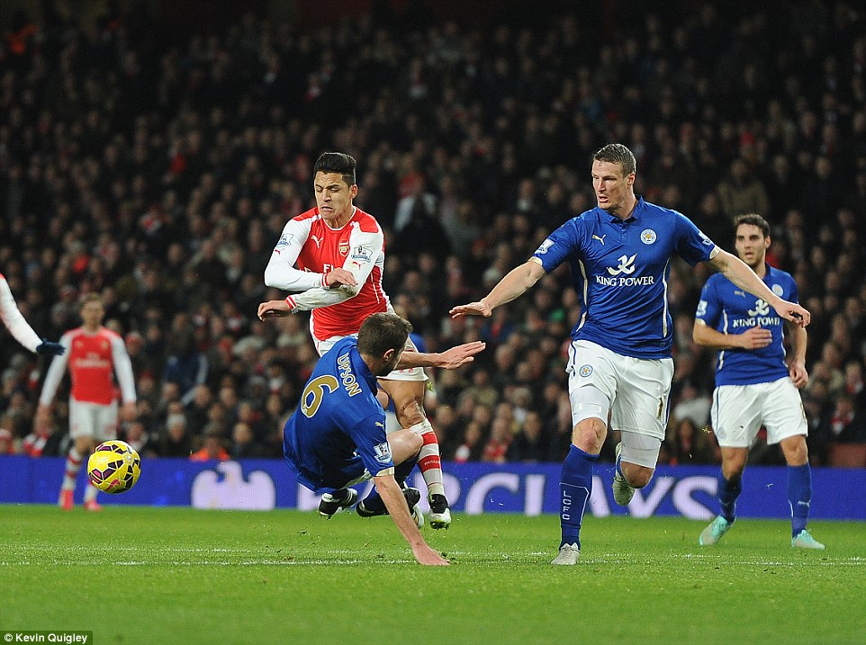 Matthew Upson's flying tackle collects Alexis Sanchez as the Chilean marksman gets airborne