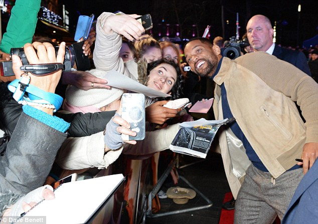 He's the man: Will proved he can still draw a large crowd as he was hounded by fans wanting to get a picture with the star