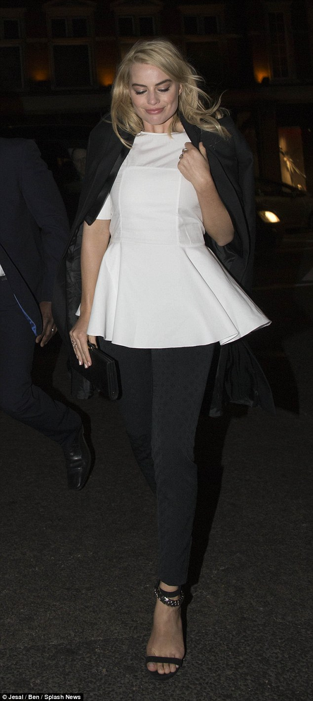Job done: Margot was seen making her way back to her London hotel in a white peplum top and black trousers