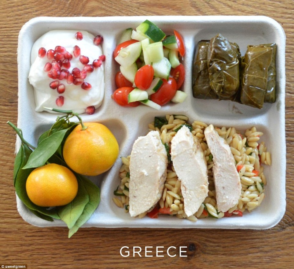 Greek school lunches feature baked chicken with orzo, stuffed grape leaves, salad of cucumber and tomatoes, yogurt with pomegranate seeds and two oranges