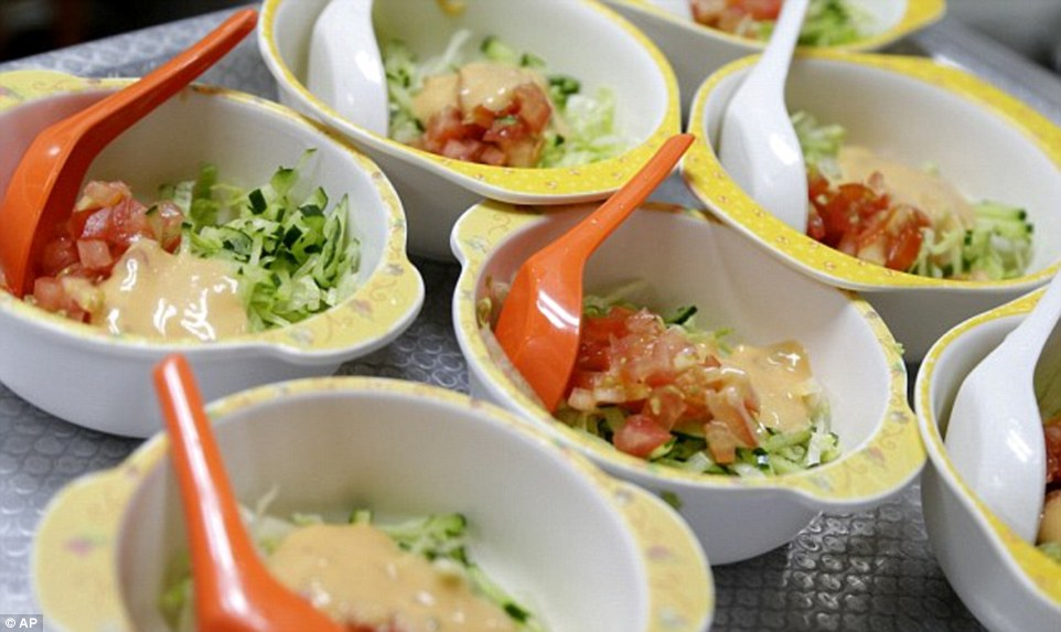Bowls of salad are ready to be served at Delcare Edu Center, a local kindergarten and child care center in the business district of Singapore