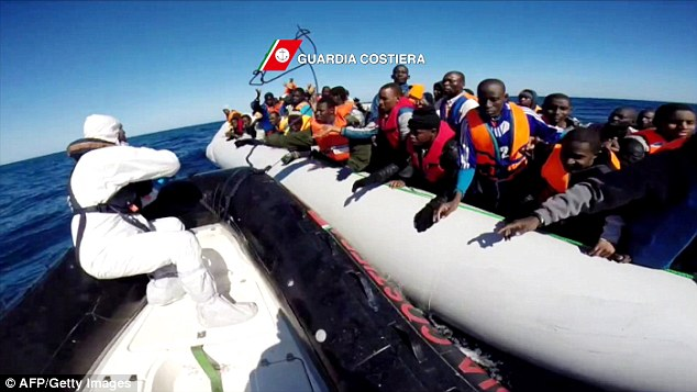 'Psychological attack': If ISIS make good on their threat of sending half a million migrants all at once to Europe, emergency services such as the Italian Coast Guards (pictured off the coast of Sicily) may not be able to cope