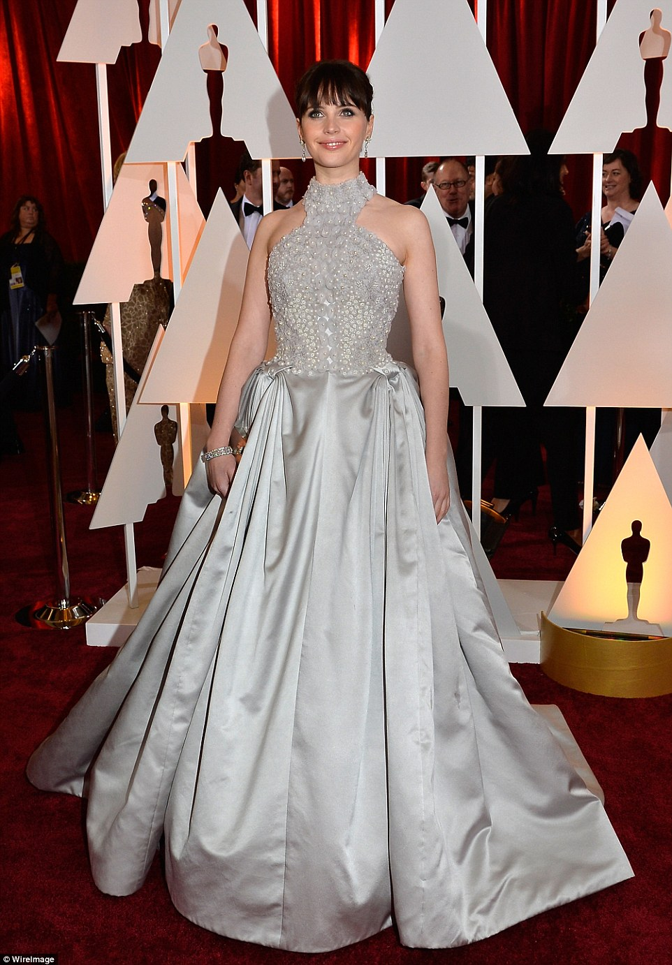 The Theory of impeccable style: Actress Felicity Jones led the glamour at the Hollywood & Highland Center in a regal embroidered halterneck gown by Alexander McQueen, which featured a off-grey skirt