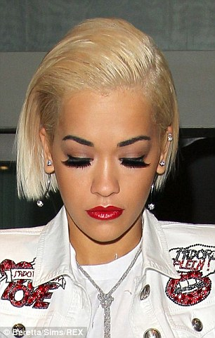 Rita Ora is pictured wearing glamorous fake eyelashes, which experts say are 'not the best thing for the health of the eyes'