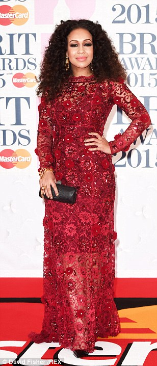 Red all about it: Paloma Faith pulled out all the stops in a prom dress and wore her hair slicked back (left) while singers Rebecca Ferguson (centre) and Jessie Ware (right) stepped out in a similar hue