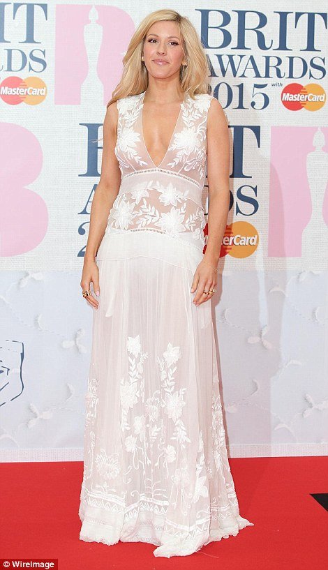 Dressed to impress: (L-R) Rita Ora (left) and Ellie Goulding (right) wore gowns with dramatic effect to the BRIT Awards 2015 at London's o2 arena on Wednesday night