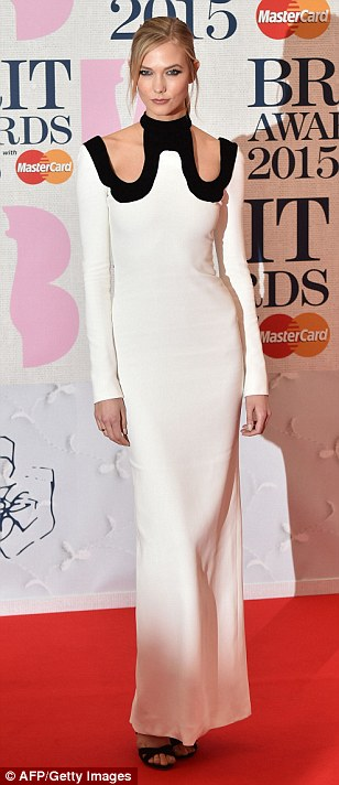 All white on the night: Model Karlie Kloss looked statuesque in her light gown with cut-out details