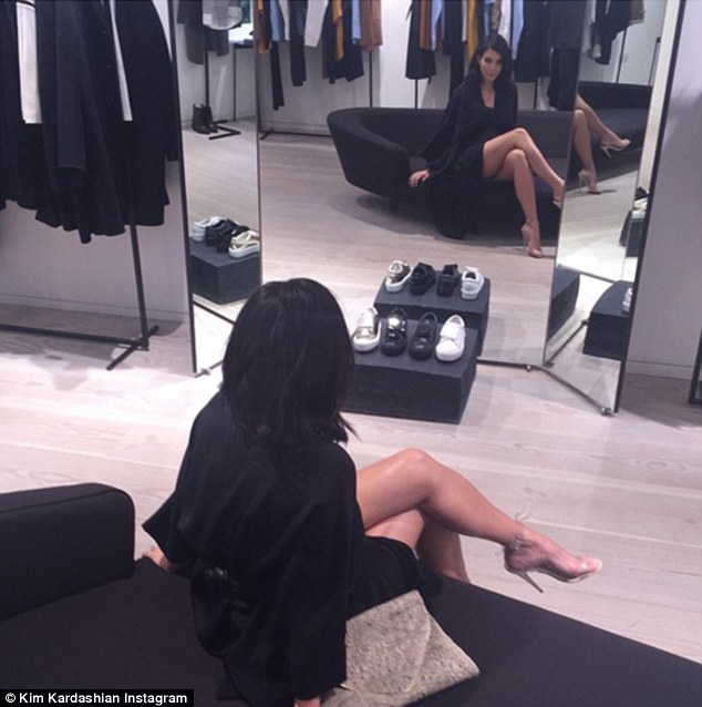Leggy lady: Kim posted this sexy snap to Instagram on Thursday and wrote: 'Waiting on bae shopping....'
