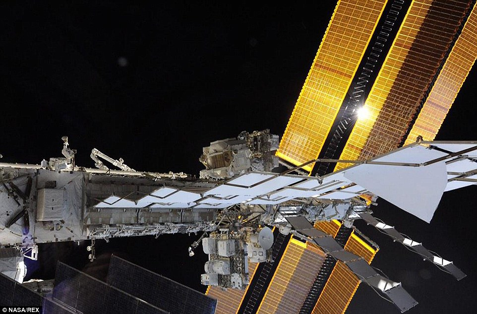 In one stunning shot, Terry Virts revealed the enormity of the ISS against the blackness of space as his fellow astronaut Butch Wilmore prepared the station for future 'space taxis'.'Can you spot the space walker in this picture?' Virts tweeted. 'He's very small compared to the enormous starboard truss of the #ISS'