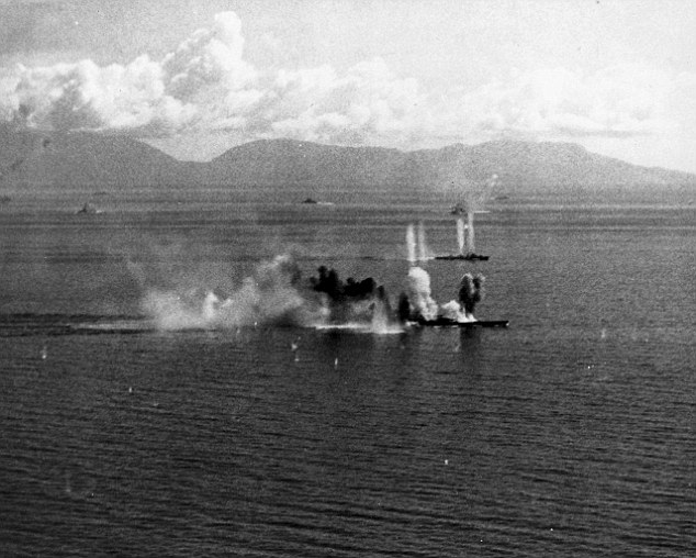 Under fire: It was considered the largest naval encounter of World War II. Pictured: The Musashi being attack