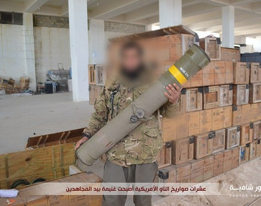 Showboating:The terrorists are seen wearing military fatigues as they pose with deadly American-made BGM-71 TOW missiles in a warehouse in Atarib, a town 15 miles west of the city of Aleppo
