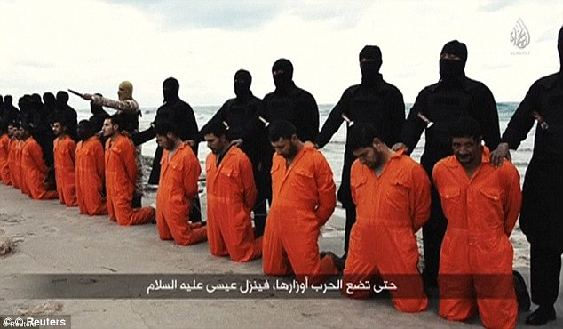 Enfriamiento: El video se desnuda un parecido sorprendente con propiedades vídeo asesinato ISIS 'de 21 cristianos coptos en una playa en Libia y sugiere los muchachos han estado estudiando las imágenes atentamente