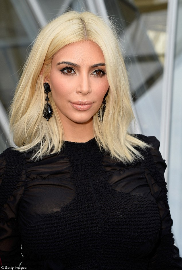 Blonde bombshell: This was the perfect opportunity for Kim to showcase her newly-dyed peroxide mane once again