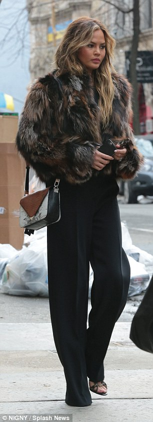 Fur enough: On Wednesday, she was covered up once again as she was seen out and about in New York City