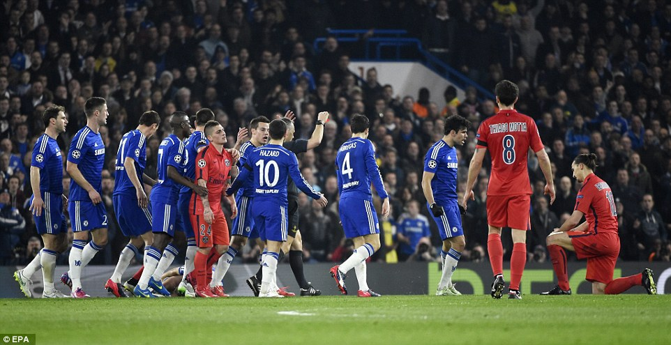 Chelsea players surround referee Bjorn Kuipers as the Dutchman sends off Zlatan Ibrahimovic (far right) on 31 minutes