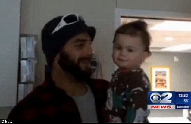 Safe: Dad Deven Trafny smiles as he looks at his daughter,Lily Groesbeck, in a video taken in hospital and released by the family. Lily has now left the hospital after surviving for 14 hours in a car wreck